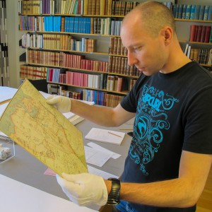 Lars studying an old map showing Armfeldts military campaign in Norway.